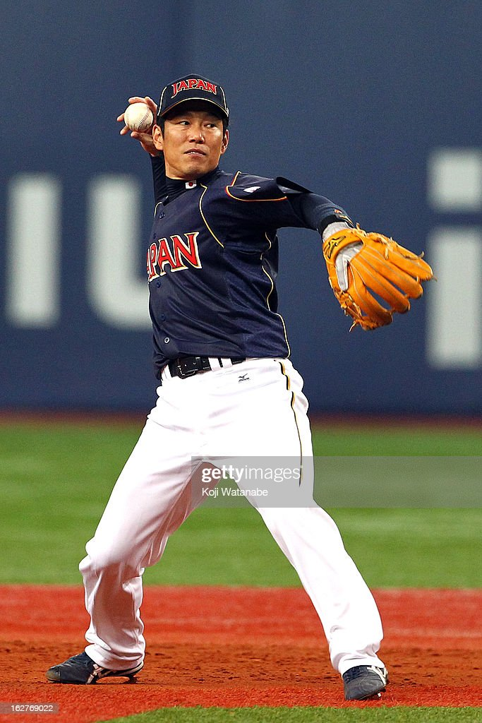 Infielder Hirokazu Ibata #3 of Japan in action during the friendly game between Hanshin Tigers and Japan at Kyocera Dome Osaka on February 26, 2013 in Osaka, Japan.