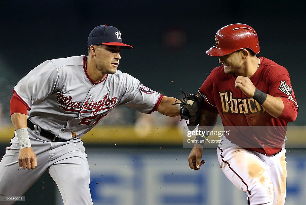 Infielder <a gi-track='captionPersonalityLinkClicked' href=/galleries/search?phrase=Ian+Desmond&family=editorial&specificpeople=835572 ng-click='$event.stopPropagation()'>Ian Desmond</a> #20 of the Washington Nationals tags out <a gi-track='captionPersonalityLinkClicked' href=/galleries/search?phrase=Gerardo+Parra&family=editorial&specificpeople=4959447 ng-click='$event.stopPropagation()'>Gerardo Parra</a> #8 of the Arizona Diamondbacks in a rundown during the third inning of the MLB game at Chase Field on May 14, 2014 in Phoenix, Arizona. The Nationals defeated the Diamondbacks 5-1.