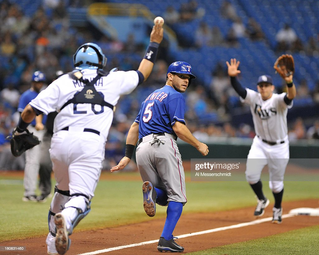 Infielder <a gi-track='captionPersonalityLinkClicked' href=/galleries/search?phrase=Ian+Kinsler&family=editorial&specificpeople=538104 ng-click='$event.stopPropagation()'>Ian Kinsler</a> #5 of the Texas Rangers is caught in a run down at home plate against the Tampa Bay Rays September 16, 2013 at Tropicana Field in St. Petersburg, Florida.
