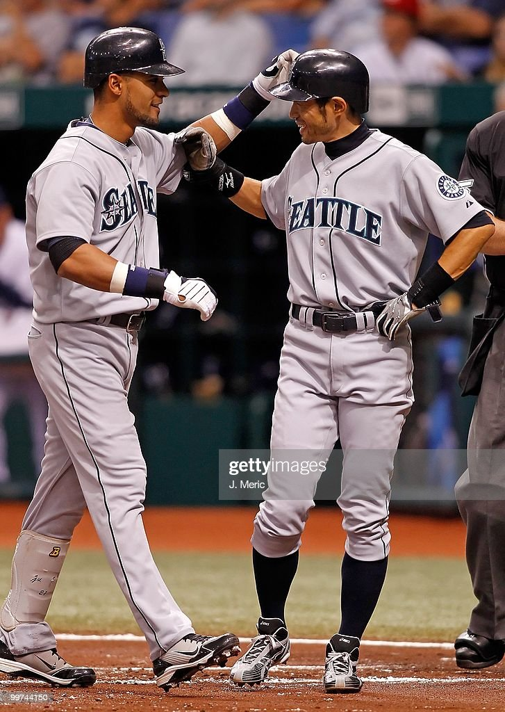 Infielder Ichiro Suzuki #51 of the Seattle Mariners congratulates Franklin Gutierrez #21 (left) after his home run against the Tampa Bay Rays during the game at Tropicana Field on May 14, 2010 in St. Petersburg, Florida.