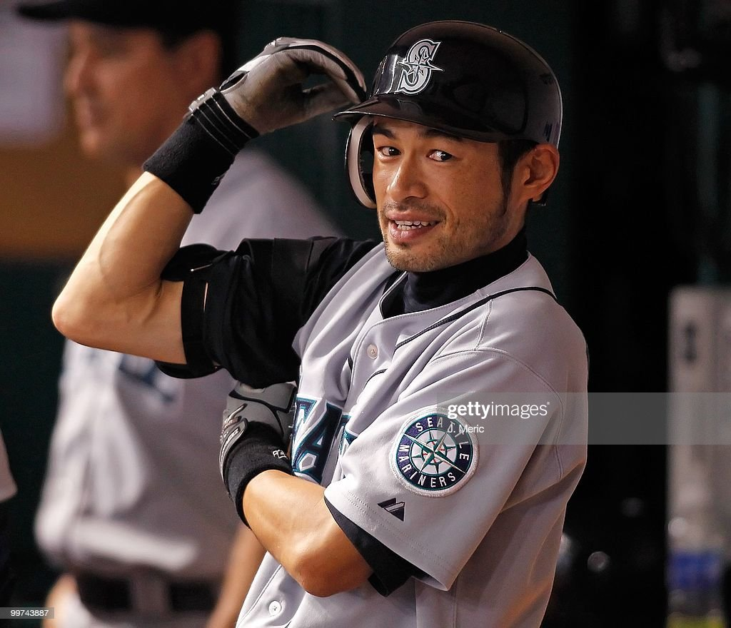 Infielder Ichiro Suzuki #51 of the Seattle Mariners puts on a brace in the dugout against the Tampa Bay Rays during the game at Tropicana Field on May 14, 2010 in St. Petersburg, Florida.