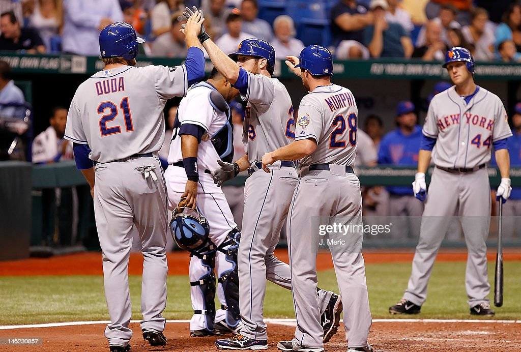 Infielder <a gi-track='captionPersonalityLinkClicked' href=/galleries/search?phrase=Ike+Davis&family=editorial&specificpeople=2349664 ng-click='$event.stopPropagation()'>Ike Davis</a> #29 (center) of the New York Mets is congratulated by teammates <a gi-track='captionPersonalityLinkClicked' href=/galleries/search?phrase=Lucas+Duda&family=editorial&specificpeople=7172550 ng-click='$event.stopPropagation()'>Lucas Duda</a> #21 and Daniel Murphy #28 after his home run against the Tampa Bay Rays during the game at Tropicana Field on June 12, 2012 in St. Petersburg, Florida.