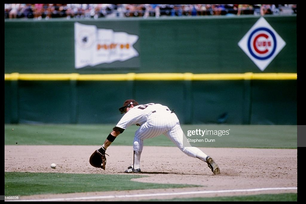 Infielder Jack Clark of the San Diego Padres dives for the ball during a game at Jack Murphy Stadium in San Diego California Mandatory Credit Stephen...