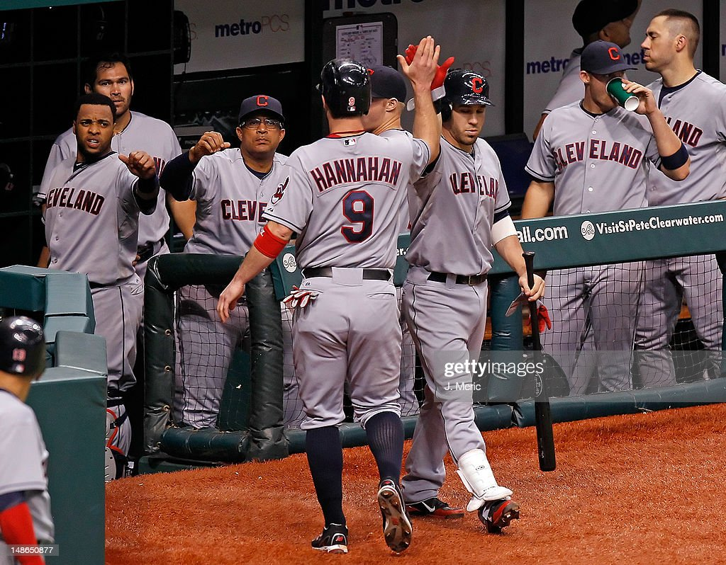 Infielder <a gi-track='captionPersonalityLinkClicked' href=/galleries/search?phrase=Jack+Hannahan&family=editorial&specificpeople=579381 ng-click='$event.stopPropagation()'>Jack Hannahan</a> #9 of the Cleveland Indians is congratulated after scoring against the Tampa Bay Rays during the game at Tropicana Field on July 18, 2012 in St. Petersburg, Florida.