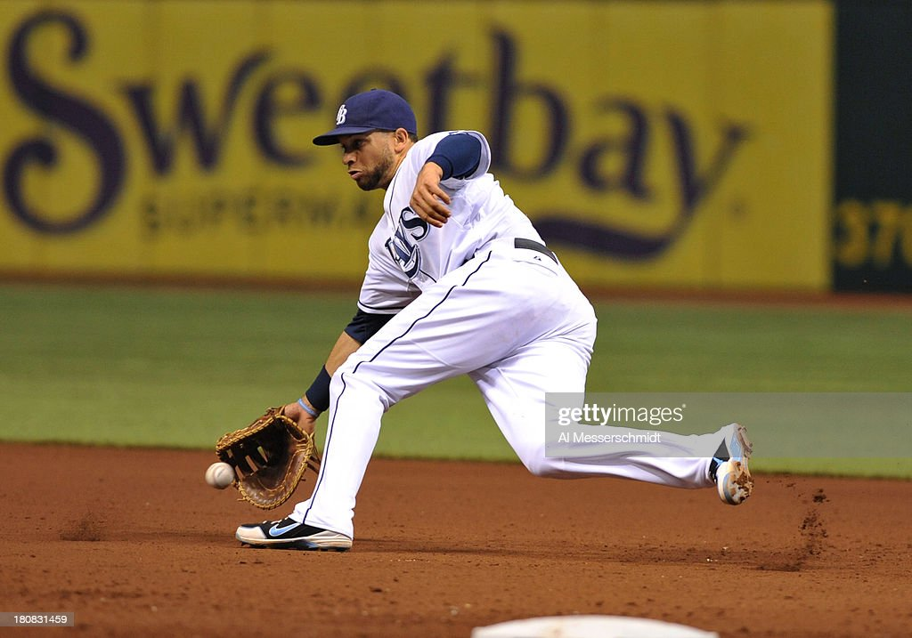 Infielder <a gi-track='captionPersonalityLinkClicked' href=/galleries/search?phrase=James+Loney&family=editorial&specificpeople=636293 ng-click='$event.stopPropagation()'>James Loney</a> #21 of the Tampa Bay Rays fields a ball at 1st base against the Texas Rangers September 16, 2013 at Tropicana Field in St. Petersburg, Florida.