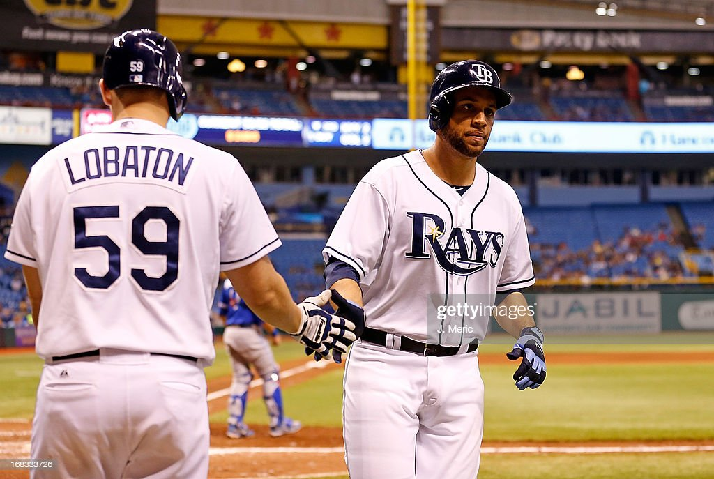 infielder James Loney #21 of the Tampa Bay Rays is congratulated after scoring a run against the Toronto Blue Jays during the game at Tropicana Field on May 8, 2013 in St. Petersburg, Florida.