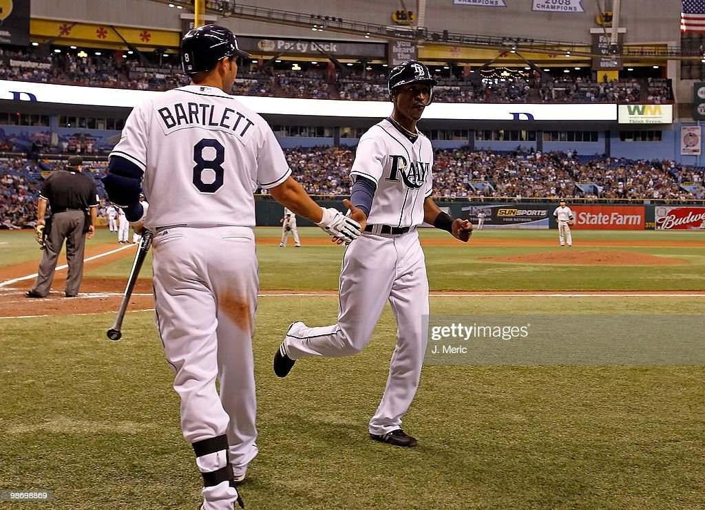 Infielder Jason Bartlett #8 congratulates outfielder B.J. Upton #2 of the Tampa Bay Rays after scoring a run against the Toronto Blue Jays during the game at Tropicana Field on April 24, 2010 in St. Petersburg, Florida.