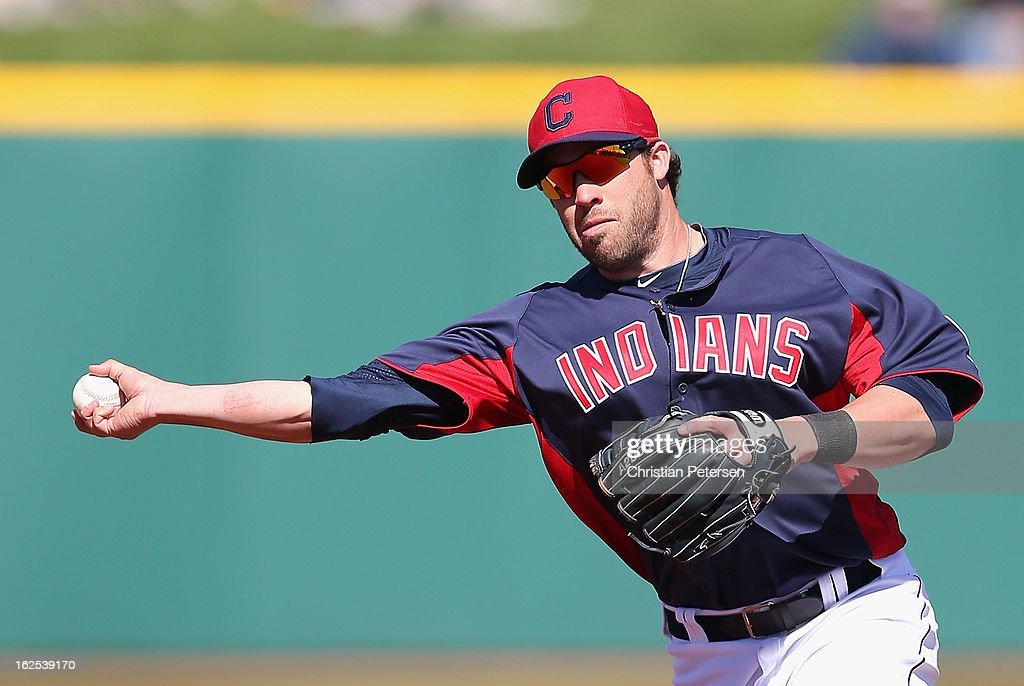 Infielder <a gi-track='captionPersonalityLinkClicked' href=/galleries/search?phrase=Jason+Kipnis&family=editorial&specificpeople=5330784 ng-click='$event.stopPropagation()'>Jason Kipnis</a> #22 of the Cleveland Indians fields a ground ball out against the Cincinnati Reds during the spring training game at Goodyear Ballpark on February 24, 2013 in Goodyear, Arizona