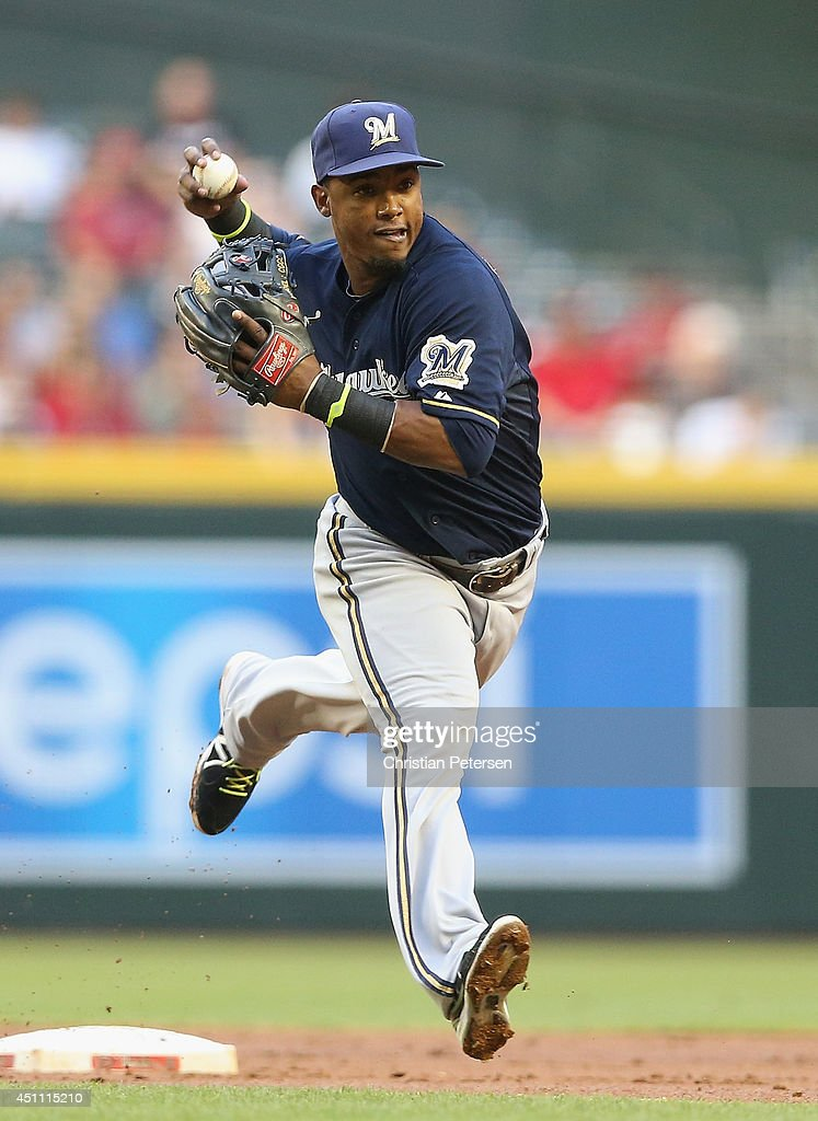 Infielder Jean Segura of the Milwaukee Brewers fields a ground ball out against the Arizona Diamondbacks during the MLB game at Chase Field on June...