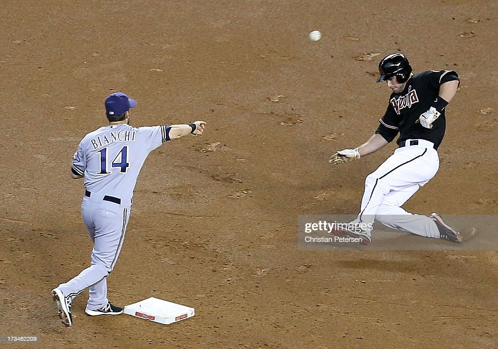 Infielder Jeff Bianchi #14 of the Milwaukee Brewers throws over <a gi-track='captionPersonalityLinkClicked' href=/galleries/search?phrase=Paul+Goldschmidt&family=editorial&specificpeople=7511120 ng-click='$event.stopPropagation()'>Paul Goldschmidt</a> #44 of the Arizona Diamondbacks to complete a double play during the fifth inning of the MLB game at Chase Field on July 14, 2013 in Phoenix, Arizona. The Brewers defeated the Diamondbacks 5-1.