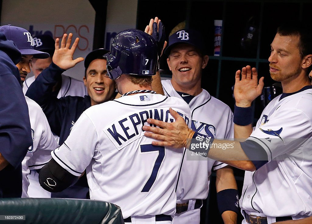 Infielder <a gi-track='captionPersonalityLinkClicked' href=/galleries/search?phrase=Jeff+Keppinger&family=editorial&specificpeople=835796 ng-click='$event.stopPropagation()'>Jeff Keppinger</a> #7 of the Tampa Bay Rays is congratulated after his home run against the Boston Red Sox during the game at Tropicana Field on September 19, 2012 in St. Petersburg, Florida.
