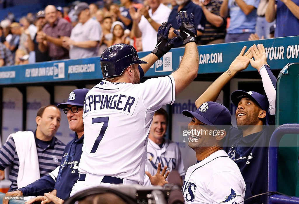 Infielder <a gi-track='captionPersonalityLinkClicked' href=/galleries/search?phrase=Jeff+Keppinger&family=editorial&specificpeople=835796 ng-click='$event.stopPropagation()'>Jeff Keppinger</a> #7 of the Tampa Bay Rays is congratulated by pitcher <a gi-track='captionPersonalityLinkClicked' href=/galleries/search?phrase=David+Price+-+Baseball+Player&family=editorial&specificpeople=4961936 ng-click='$event.stopPropagation()'>David Price</a> #14 and infielder Carlos Pena #23 (center) after his home run against the Kansas City Royals during the game at Tropicana Field on August 20, 2012 in St. Petersburg, Florida.