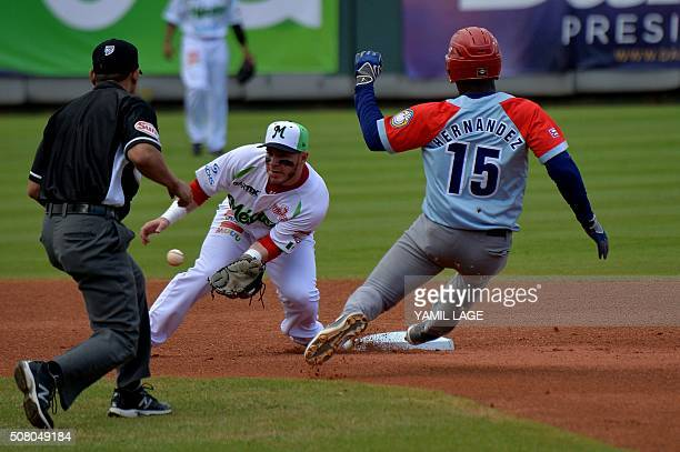 Infielder Jesus Esteban Quiroz of Mexico makes an out on second base against Staile Hernandez of Cuba during their 2016 Caribbean baseball series...