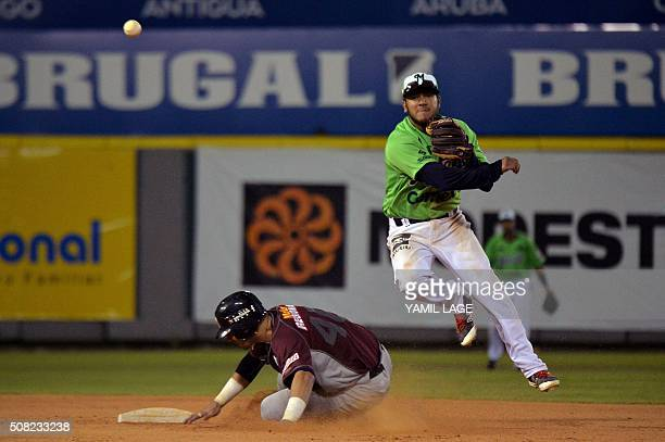 Infielder Jesus Quiroz of Mexico makes an out on second base against Darien Alvares of Venezuela during their 2016 Caribbean baseball series game on...