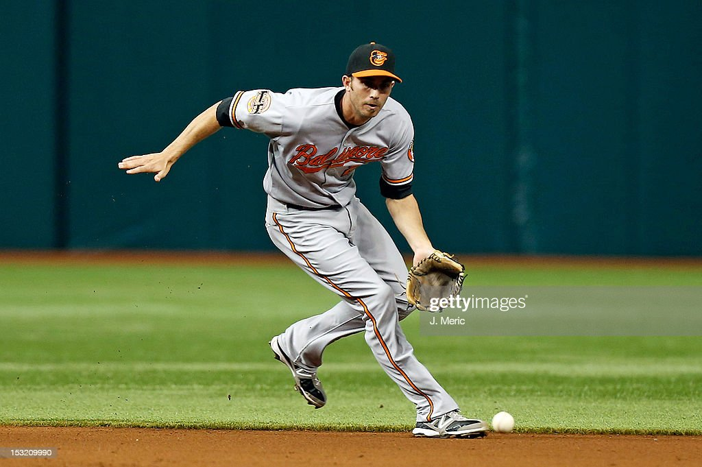 Infielder <a gi-track='captionPersonalityLinkClicked' href=/galleries/search?phrase=J.J.+Hardy&family=editorial&specificpeople=216446 ng-click='$event.stopPropagation()'>J.J. Hardy</a> #2 of the Baltimore Orioles fields a ground ball against the Tampa Bay Rays during the game at Tropicana Field on October 1, 2012 in St. Petersburg, Florida.