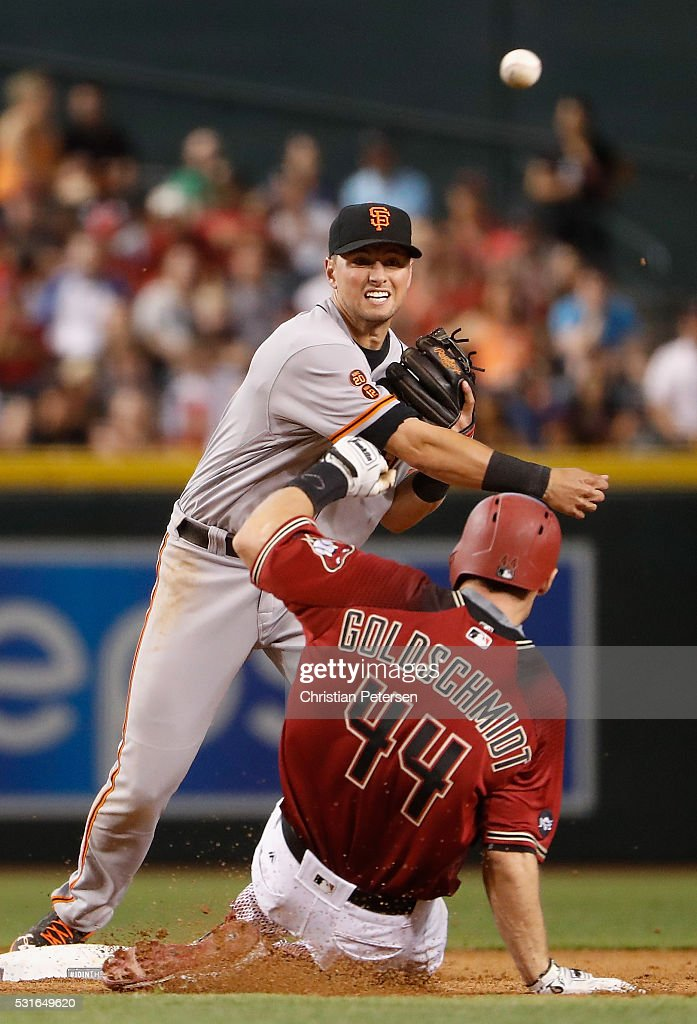 Infielder Joe Panik of the San Francisco Giants throws over the sliding Paul Goldschmidt of the Arizona Diamondbacks to complete a double play during...
