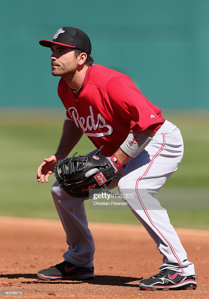 Infielder <a gi-track='captionPersonalityLinkClicked' href=/galleries/search?phrase=Joey+Votto&family=editorial&specificpeople=759319 ng-click='$event.stopPropagation()'>Joey Votto</a> #19 of the Cincinnati Reds in action during the spring training game against the Cleveland Indians at Goodyear Ballpark on February 24, 2013 in Goodyear, Arizona