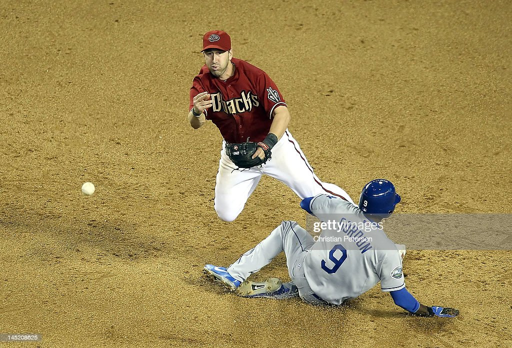 Infielder <a gi-track='captionPersonalityLinkClicked' href=/galleries/search?phrase=John+McDonald+-+Baseball+Player&family=editorial&specificpeople=215395 ng-click='$event.stopPropagation()'>John McDonald</a> #16 of the Arizona Diamondbacks throws over the sliding <a gi-track='captionPersonalityLinkClicked' href=/galleries/search?phrase=Dee+Gordon&family=editorial&specificpeople=7091343 ng-click='$event.stopPropagation()'>Dee Gordon</a> #9 of the Los Angeles Dodgers to complete a game ending double play during the ninth inning of the MLB game at Chase Field on May 23, 2012 in Phoenix, Arizona.