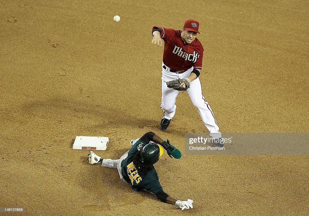 Infielder <a gi-track='captionPersonalityLinkClicked' href=/galleries/search?phrase=John+McDonald+-+Baseball+Player&family=editorial&specificpeople=215395 ng-click='$event.stopPropagation()'>John McDonald</a> #16 of the Arizona Diamondbacks throws over the sliding <a gi-track='captionPersonalityLinkClicked' href=/galleries/search?phrase=Jemile+Weeks&family=editorial&specificpeople=4583261 ng-click='$event.stopPropagation()'>Jemile Weeks</a> #19 of the Oakland Athletics as he attempts an unsuccessful double play during the seventh inning of the interleague MLB game at Chase Field on June 10, 2012 in Phoenix, Arizona.