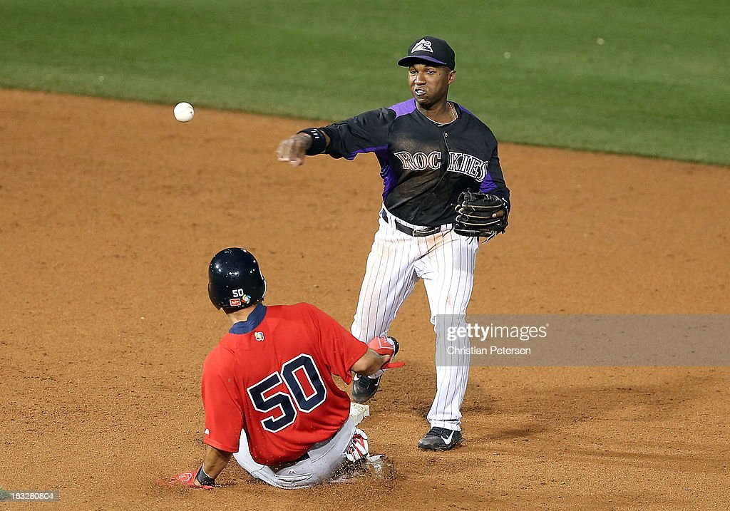 Infielder <a gi-track='captionPersonalityLinkClicked' href=/galleries/search?phrase=Jonathan+Herrera&family=editorial&specificpeople=4175178 ng-click='$event.stopPropagation()'>Jonathan Herrera</a> #18 of the Colorado Rockies throws over the sliding <a gi-track='captionPersonalityLinkClicked' href=/galleries/search?phrase=Shane+Victorino&family=editorial&specificpeople=576251 ng-click='$event.stopPropagation()'>Shane Victorino</a> #50 of Team USA to complete a double play during the spring training game at Salt River Fields at Talking Stick on March 6, 2013 in Scottsdale, Arizona.