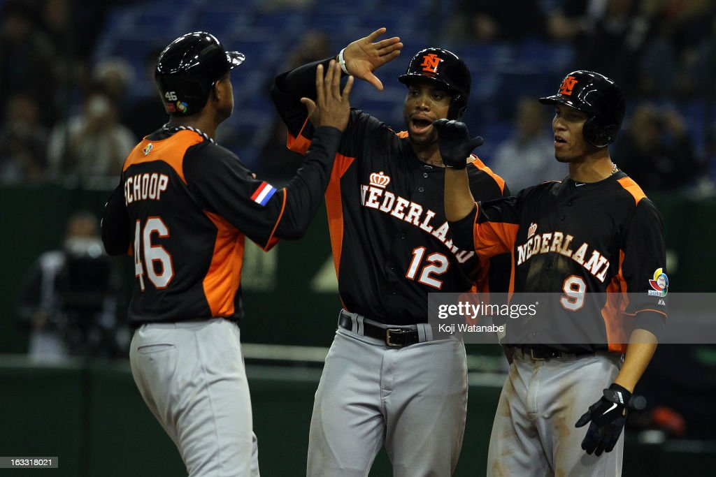 Infielder Jonathan Schoop #46 of the Netherlands celebrates after scoring hits a three run home run with teammate in the top half of the sixth inning during the World Baseball Classic Second Round Pool 1 game between the Netherlands and Cuba at Tokyo Dome on March 8, 2013 in Tokyo, Japan.
