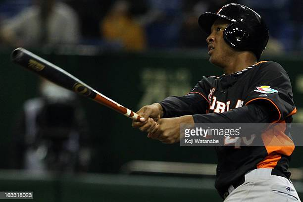 Infielder Jonathan Schoop of the Netherlands hits a three run home run in the top half of the sixth inning during the World Baseball Classic Second...