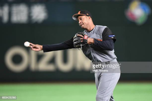 Infielder Jonathan Schoop of the Netherlands throws to the first base after fielding a grounder by Outfielder Roel Santos of Cuba in the bottom of...