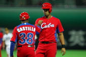 Infielder Jose Abreu of Cuba celebrates in the top half of the seventh inning during the friendly game between Fukuoka Softbank Hawks and Cuba at...