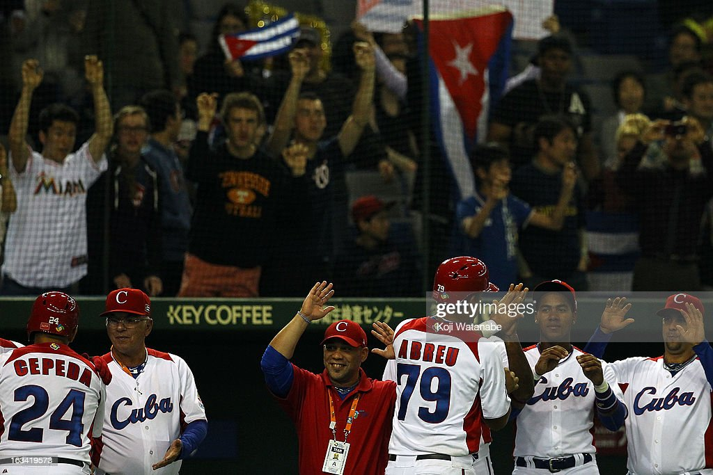Infielder Jose Abreu #79 of Cuba celerates after scoring during the World Baseball Classic Second Round Pool 1 game between Chinese Taipei and Cuba at Tokyo Dome on March 9, 2013 in Tokyo, Japan.