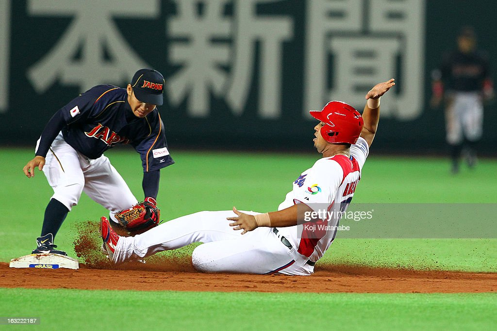 Infielder Jose Abreu #79 of Cuba slides in to second during the World Baseball Classic First Round Group A game between Japan and Cuba at Fukuoka Yahoo! Japan Dome on March 6, 2013 in Fukuoka, Japan.