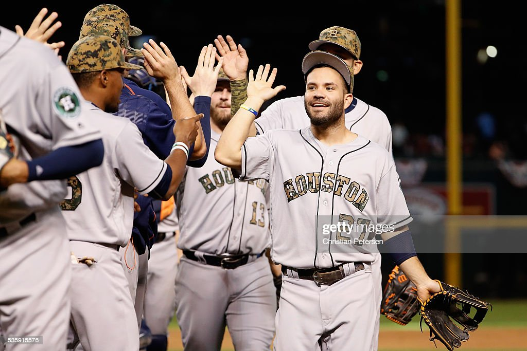 Infielder <a gi-track='captionPersonalityLinkClicked' href=/galleries/search?phrase=Jose+Altuve&family=editorial&specificpeople=7934195 ng-click='$event.stopPropagation()'>Jose Altuve</a> #27 of the Houston Astros celebrates with teammates after defeating the Arizona Diamondbacks 8-3 in the MLB game at Chase Field on May 30, 2016 in Phoenix, Arizona.