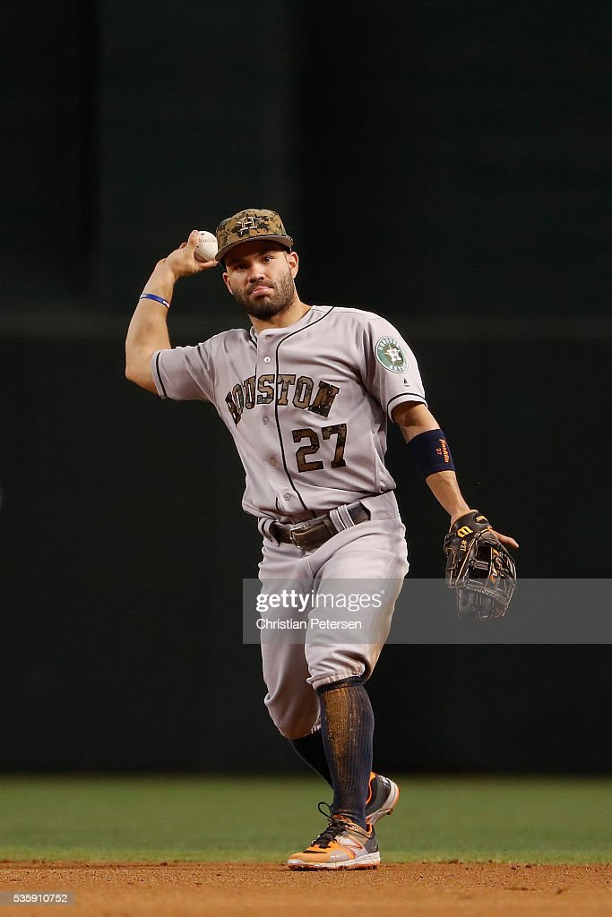 Infielder <a gi-track='captionPersonalityLinkClicked' href=/galleries/search?phrase=Jose+Altuve&family=editorial&specificpeople=7934195 ng-click='$event.stopPropagation()'>Jose Altuve</a> #27 of the Houston Astros fields a ground ball out against the Arizona Diamondbacks during the fourth inning of the MLB game at Chase Field on May 30, 2016 in Phoenix, Arizona.
