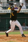 Infielder Jose Castillo of the Pittsburgh Pirates at bat against the Cincinnati Reds during Spring Training on March 4 2004 at McKechnie Field in...