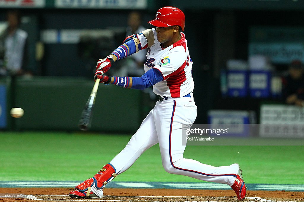 Infielder Jose Fernandez #8 of Cuba at bat during the World Baseball Classic First Round Group A game between Japan and Cuba at Fukuoka Yahoo! Japan Dome on March 6, 2013 in Fukuoka, Japan.