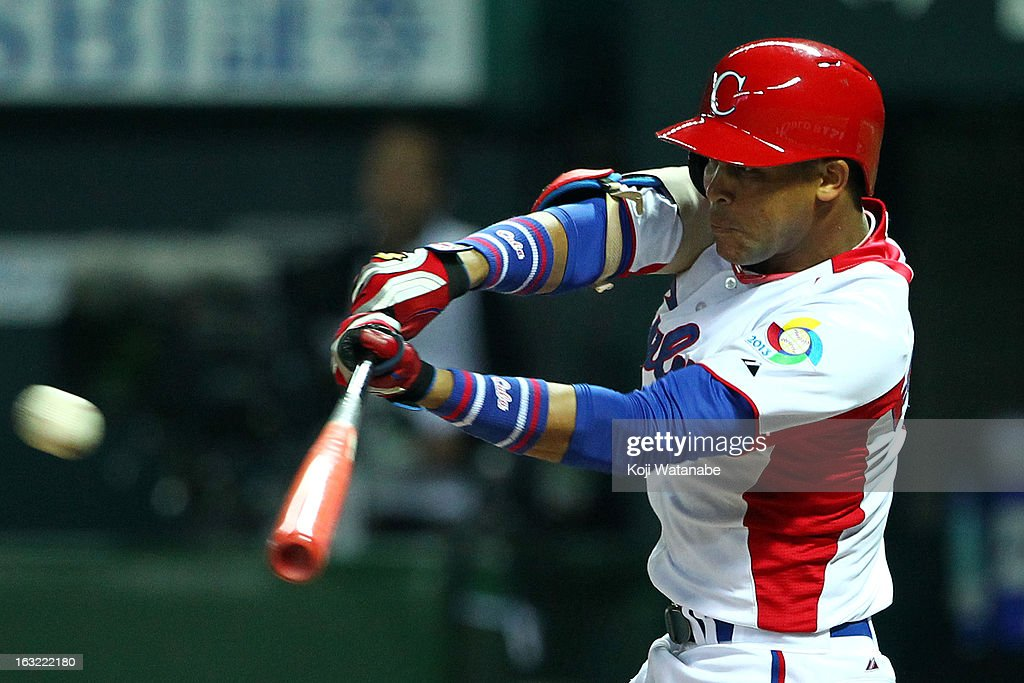 Infielder Jose Fernandez #8 of Cuba hits a double in the bottom half of the sixth inningduring the World Baseball Classic First Round Group A game between Japan and Cuba at Fukuoka Yahoo! Japan Dome on March 6, 2013 in Fukuoka, Japan.