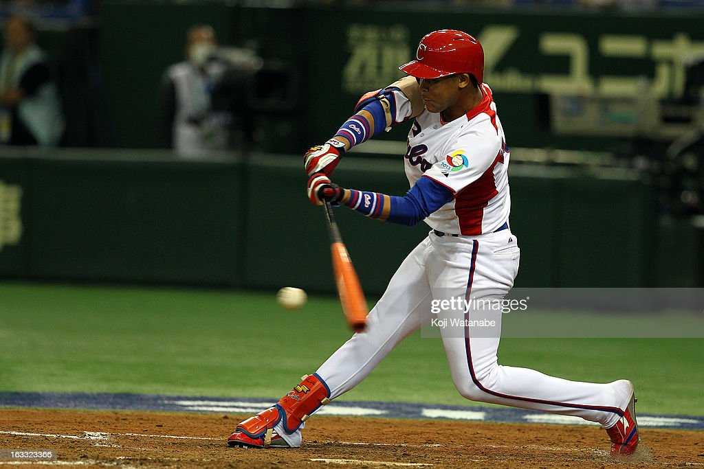 Infielder Jose Fernandez #8 of Cuba hits a double in the top half of the first inning during the World Baseball Classic Second Round Pool 1 game between the Netherland and Cuba at Tokyo Dome on March 8, 2013 in Tokyo, Japan.