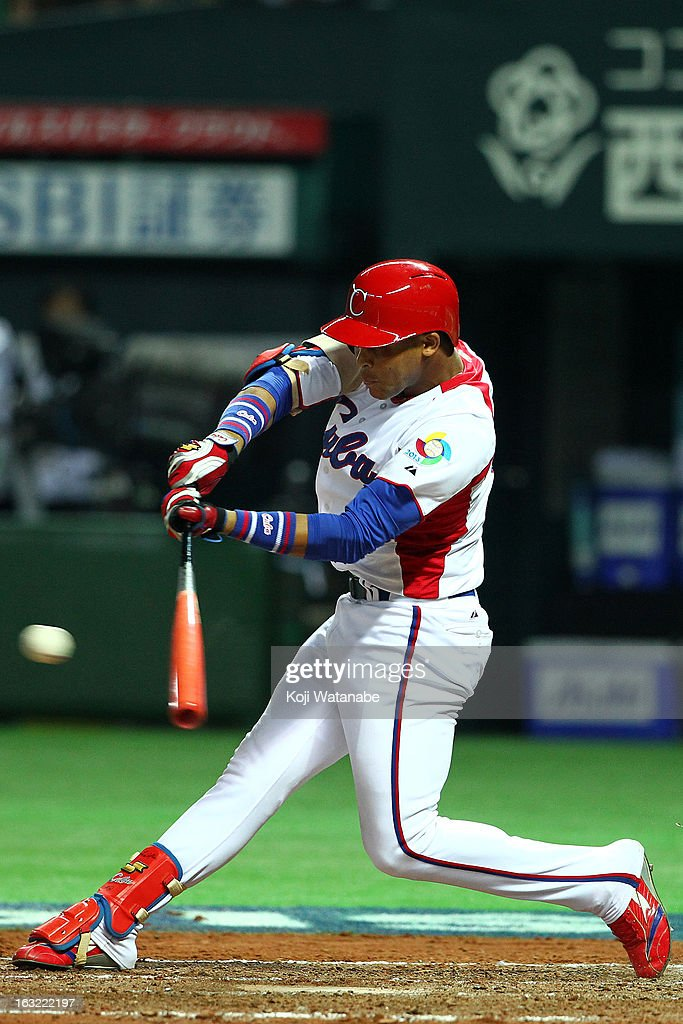 Infielder Jose Fernandez #8 of Cuba hits a single in the bottom half of the fourthh inningduring the World Baseball Classic First Round Group A game between Japan and Cuba at Fukuoka Yahoo! Japan Dome on March 6, 2013 in Fukuoka, Japan.