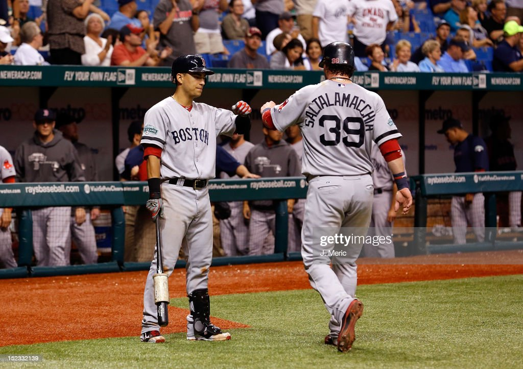 Infielder Jose Iglesias #58 of the Boston Red Sox congratulates <a gi-track='captionPersonalityLinkClicked' href=/galleries/search?phrase=Jarrod+Saltalamacchia&family=editorial&specificpeople=836404 ng-click='$event.stopPropagation()'>Jarrod Saltalamacchia</a> #39 after scoring against the Tampa Bay Rays during the game at Tropicana Field on September 18, 2012 in St. Petersburg, Florida.