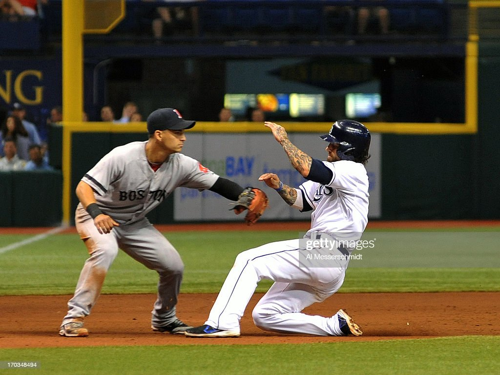 Infielder Jose Iglesias #10 of the Boston Red Sox tags sliding infielder Ryan Roberts #19 of the Tampa Bay Rays during a pickoff June 11, 2013 at Tropicana Field in St. Petersburg, Florida.