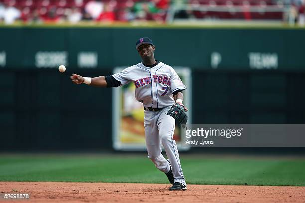 Infielder Jose Reyes of the New York Mets throws the ball against the Cincinnati Reds during the game on April 7 2005 at Great American Ballpark in...