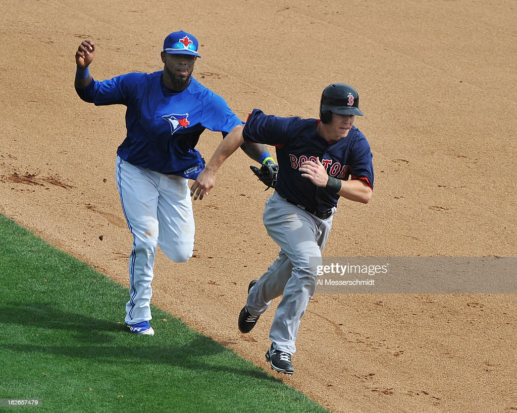 Infielder Jose Reyes #7 of the Toronto Blue Jays tags out infielder Brock Holt #26 of the Boston Red Sox in a rundown during a preason game February 25, 2013 at the Florida Auto Exchange Stadium in Dunedin, Florida.