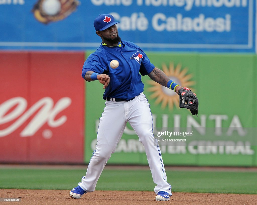 Infielder Jose Reyes #7 of the Toronto Blue Jays throws to first base against the Baltimore Orioles February 24, 2013 at the Florida Auto Exchange Stadium in Dunedin, Florida.