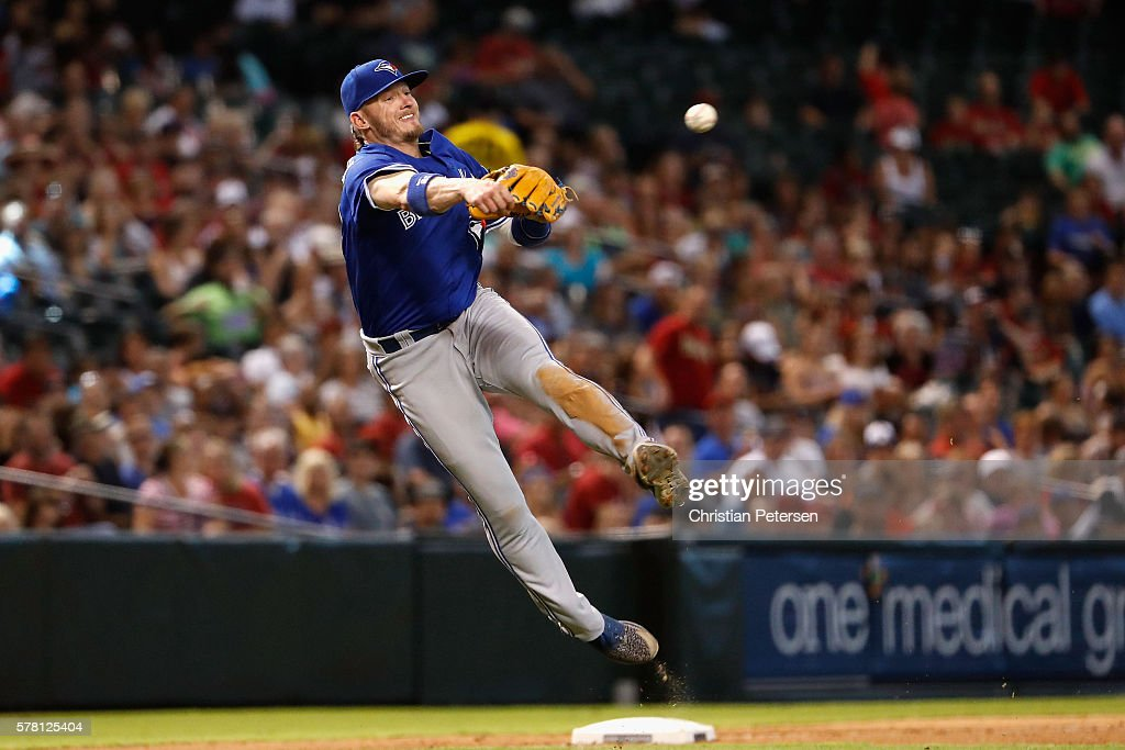 Infielder Josh Donaldson of the Toronto Blue Jays fields a ground ball out during the seventh inning of the interleague MLB game against the Arizona...
