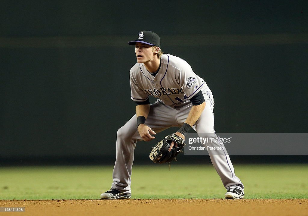 Infielder <a gi-track='captionPersonalityLinkClicked' href=/galleries/search?phrase=Josh+Rutledge&family=editorial&specificpeople=9541486 ng-click='$event.stopPropagation()'>Josh Rutledge</a> #14 of the Colorado Rockies in action during the MLB game against the Arizona Diamondbacks at Chase Field on October 2, 2012 in Phoenix, Arizona. The Diamondbacks defeated the Rockies 5-3.