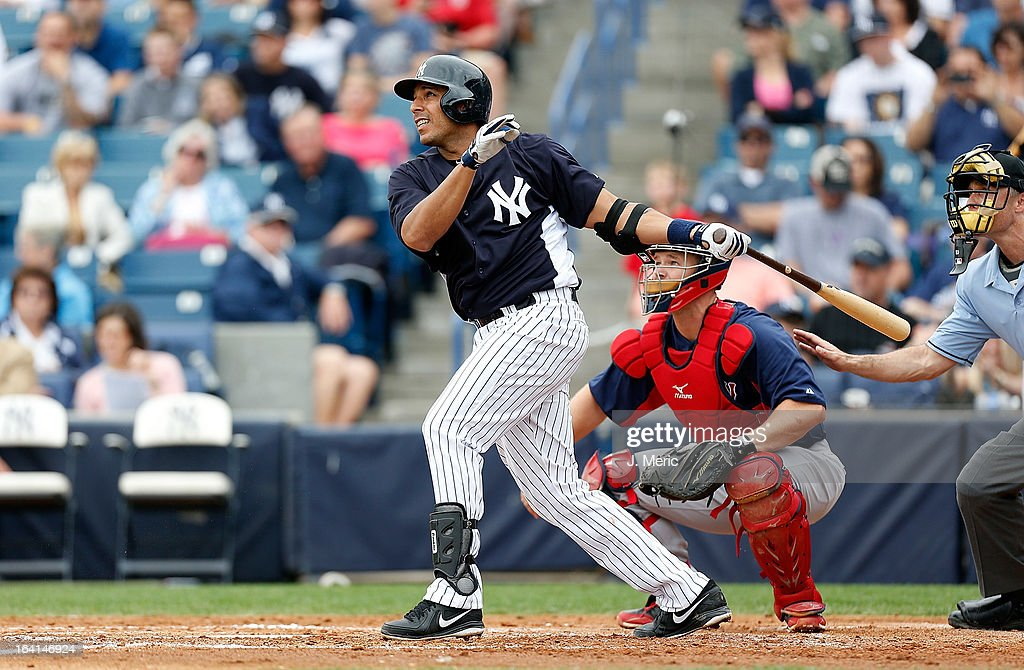 Infielder Juan Rivera #54 of the New York Yankees bats against the Boston Red Sox during a Grapefruit League Spring Training Game at George M. Steinbrenner Field on March 20, 2013 in Tampa, Florida.