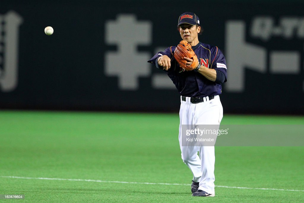Infielder <a gi-track='captionPersonalityLinkClicked' href=/galleries/search?phrase=Kazuo+Matsui&family=editorial&specificpeople=202045 ng-click='$event.stopPropagation()'>Kazuo Matsui</a> #7 of Japan in action during the friendly game between Yomiuri Giants and Japan at Fukuoka Yafuoku! Dome on February 28, 2013 in Fukuoka, Japan.