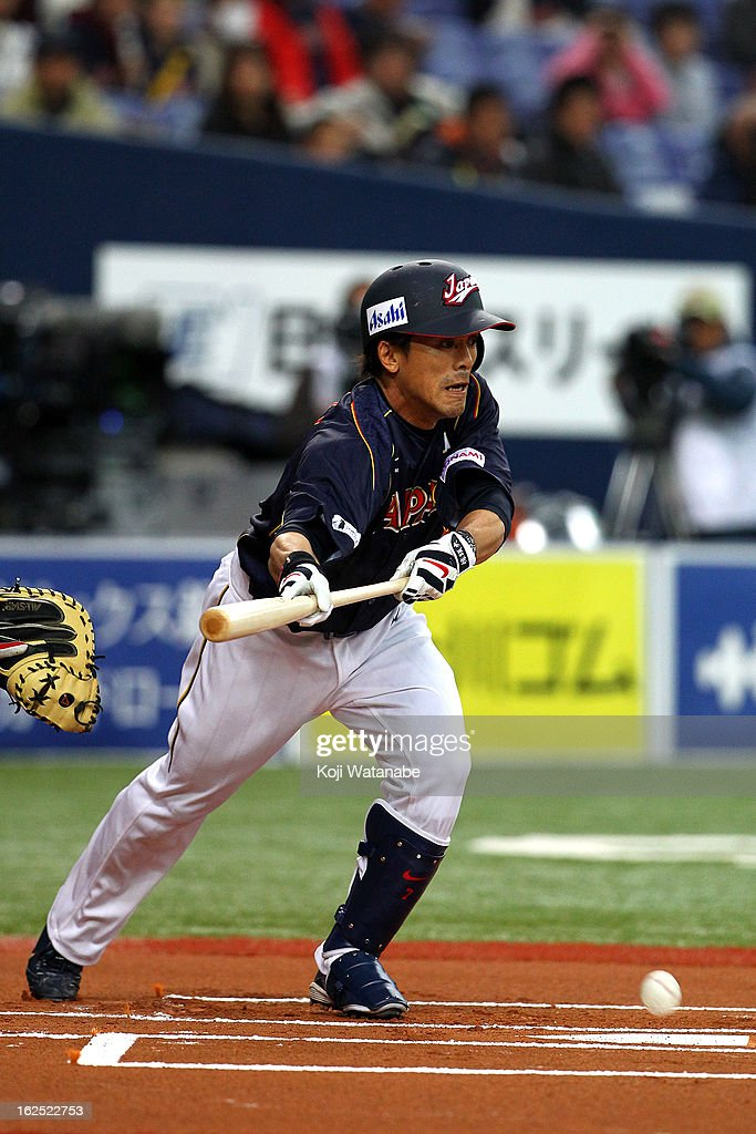 Infielder <a gi-track='captionPersonalityLinkClicked' href=/galleries/search?phrase=Kazuo+Matsui&family=editorial&specificpeople=202045 ng-click='$event.stopPropagation()'>Kazuo Matsui</a>#7 of Japan bunts during the international friendly game between Australia and Japan at Kyocera Dome Osaka on February 24, 2013 in Osaka, Japan.