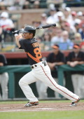 Infielder Kensuke Tanaka of San Fransisco Giants at bat during the spring training game against Cleveland Indians on March 5 2013 in Scottsdale...