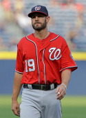 Infielder Kevin Frandsen of the Washington Nationals warms up before the game against the Atlanta Braves at Turner Field on April 12 2014 in Atlanta...