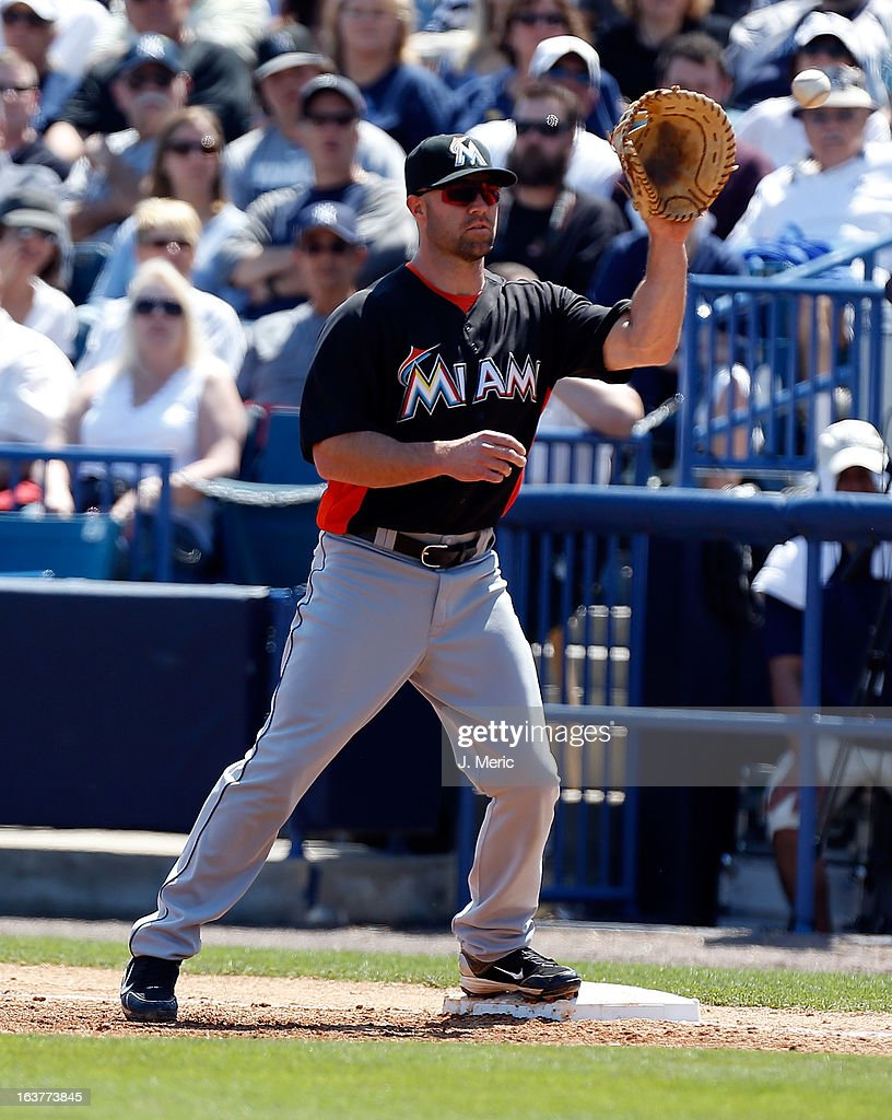 Infielder Kevin Kouzmanoff #15 of the Miami Marlins takes the throw at first against the New York Yankees during a Grapefruit League Spring Training Game at George M. Steinbrenner Field on March 15, 2013 in Tampa, Florida.
